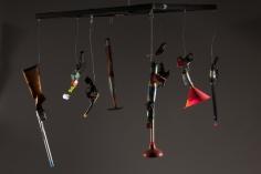 Luis Cruz Azaceta, Carousel, 2014 guns, tape, plastic, metal, wire, wood 40 x 45 x 40 inches