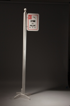 Luis Cruz Azaceta, Street Sign, 2014 acrylic, toy gun, wire, wood 100 x 17 inches