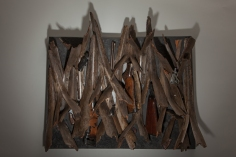 Ron Bechet, Swords to Ploughshares, 2014 palm fronds, gun parts, paint on wood panel, 37 x 42 x 6 inches