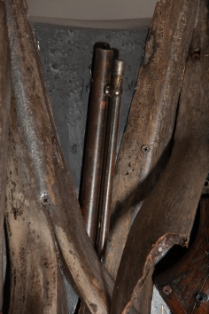 Ron Bechet, Swords to Ploughshares (detail), 2014 palm fronds, gun parts, paint on wood panel, 37 x 42 x 6 inches